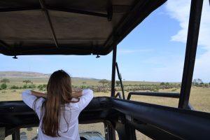 Woman overlooking Maasai Mara on safari