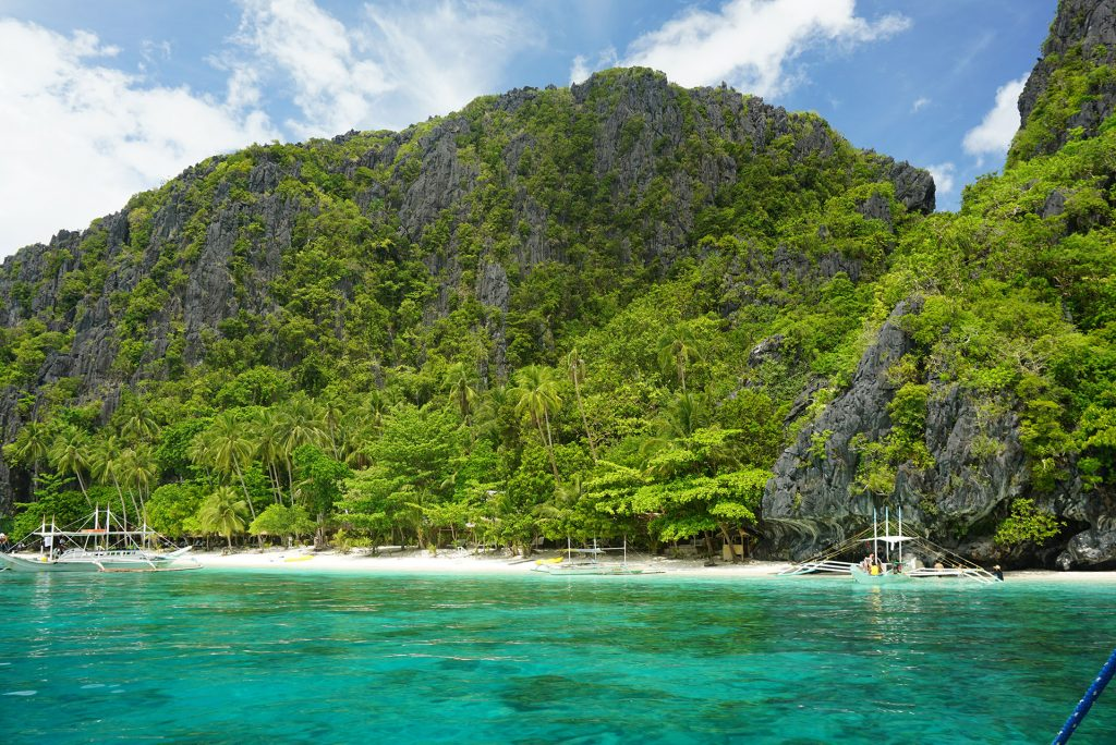 turquoise water with green hills Philippines