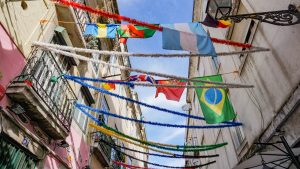 Flags hanging on buildings in Lisbon Portugal