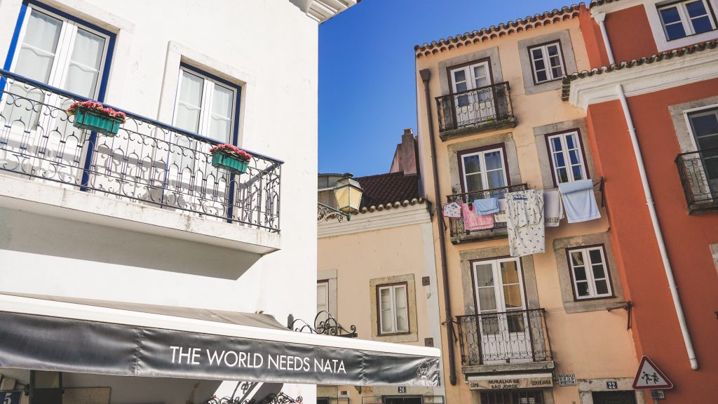 Small street with colorful houses in Lisbon